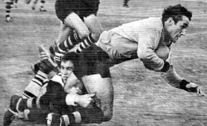 Jim Cody tackling Keith Outton