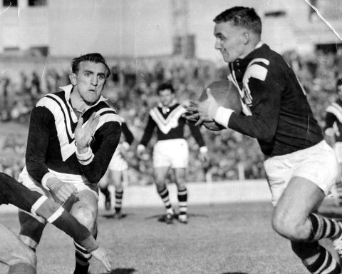 1961 Wests v Easts photo Dick Poole passing ball.