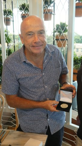 john with medal